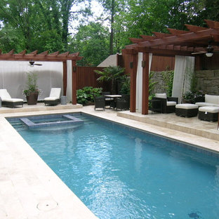 Inspiration for a mid-sized timeless backyard stone and rectangular natural hot tub remodel in Atlanta
