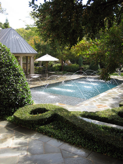 Traditional Pool by Harold Leidner Landscape Architects