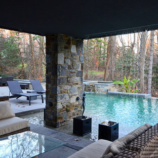 Example of a large trendy backyard custom-shaped infinity hot tub design in Baltimore