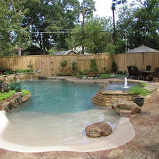 Traditional Pool by Tahitian Pools, Inc.