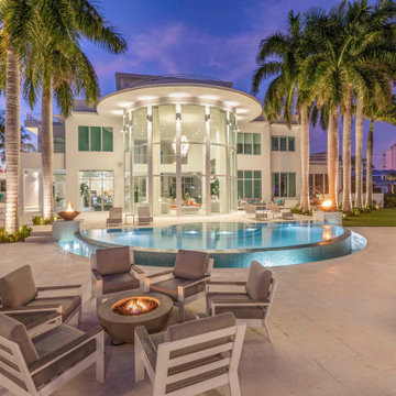 Freeform Infinity Edge Pool with Lap Pool/Spa with Fire Bowls in Ft. Lauderdale