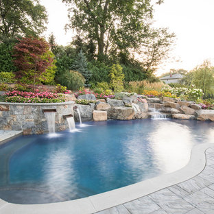 Pool fountain - traditional stamped concrete and kidney-shaped natural pool fountain idea in New York
