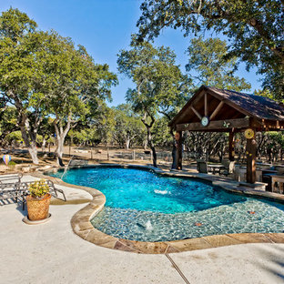 Design ideas for a large country backyard custom-shaped pool in Other.