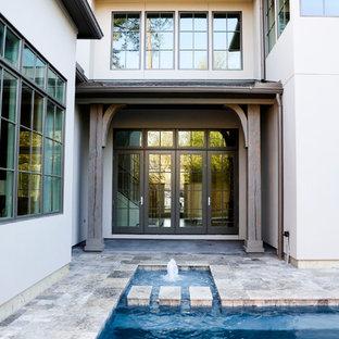Inspiration för en mellanstor funkis rektangulär ovanmarkspool på baksidan av huset, med poolhus och kakelplattor