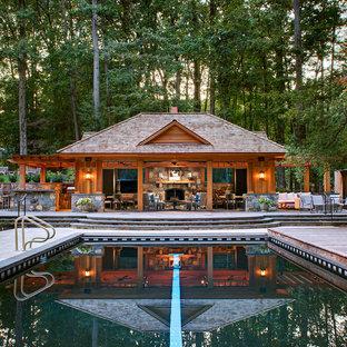 Ejemplo de casa de la piscina y piscina rural, rectangular, en patio trasero