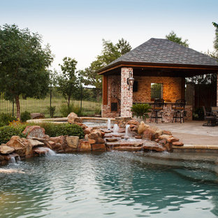 Example of a mid-sized mountain style backyard concrete paver pool design in Dallas