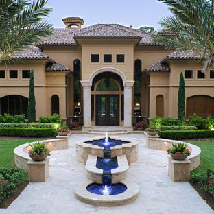 Front yard fountain feature with travertine seat walls.