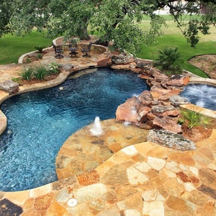 Inspiration for a mid-sized rustic backyard stone and custom-shaped natural pool fountain remodel in Austin