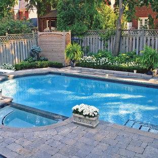 Small trendy backyard concrete paver and rectangular lap hot tub photo in Toronto