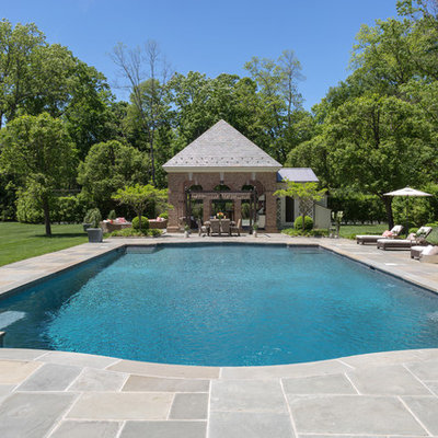 Pool house - large traditional backyard tile and rectangular lap pool house idea in New York
