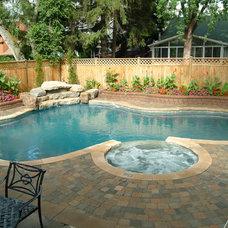 Traditional Pool by Gib-San Pools Ltd.