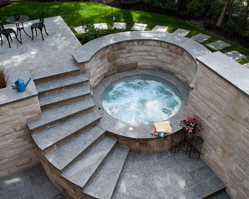 Inspiration For A Small Contemporary Backyard Round And Stone Hot Tub  Remodel In Toronto