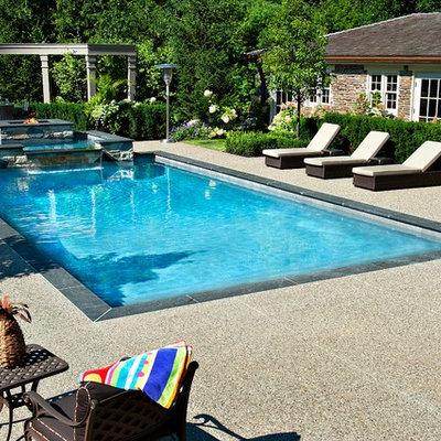 Elegant rectangular pool photo in Toronto