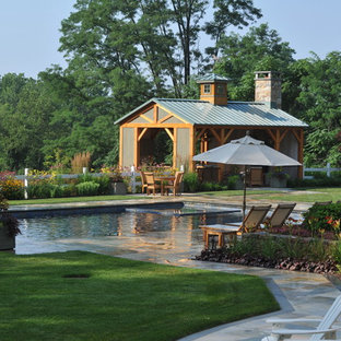 Example of a mid-sized farmhouse backyard tile and rectangular pool house design in New York