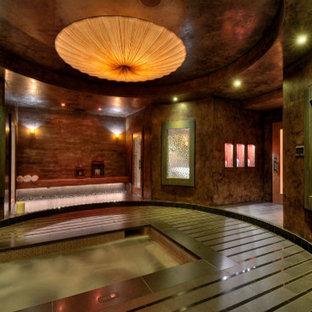 Ejemplo de piscinas y jacuzzis de estilo zen, de tamaño medio, rectangulares y interiores, con adoquines de piedra natural