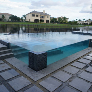 glass wall pool with sunken living room