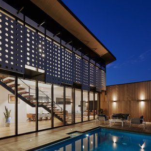 Design ideas for a contemporary rectangular pool in Melbourne with decking.