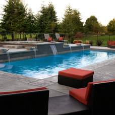 Contemporary Pool by Coyote Design Architecture + Planning PLLC