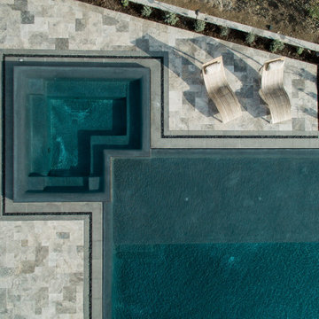 Gorgeous Infinity Pool with Multiple Outdoor Living Spaces