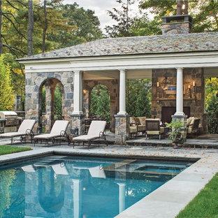 Foto de casa de la piscina y piscina clásica, extra grande, rectangular