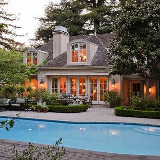 Mid-sized tuscan backyard rectangular and concrete paver lap pool photo in San Francisco