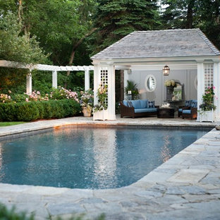 Example of a classic stone and rectangular pool design in New York