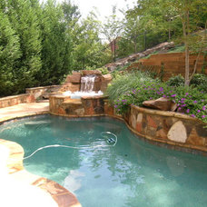 tropical pool by Legacy Landscapes, Inc.