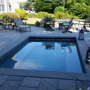 Inspiration for a modern backyard stone and l-shaped pool remodel in New York