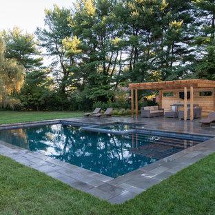 Imagen de piscinas y jacuzzis rústicos, rectangulares, con suelo de baldosas