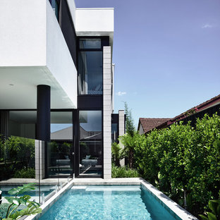 Design ideas for a small contemporary backyard rectangular lap pool in Melbourne with concrete slab.
