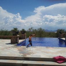 Mediterranean Pool by Hallmark Interior Design LLC