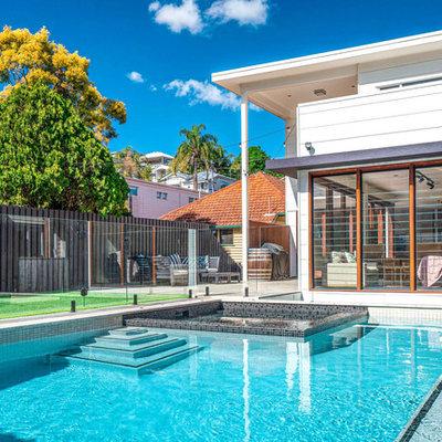Hot tub - mid-sized modern backyard tile and rectangular aboveground hot tub idea in Brisbane