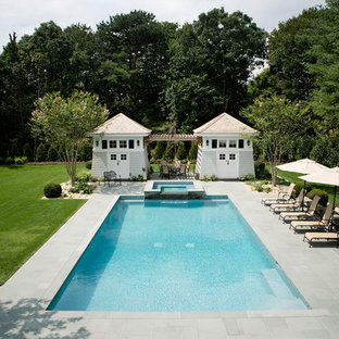 Large elegant backyard stone and rectangular natural hot tub photo in New York