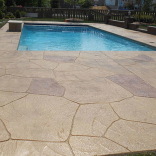 Inspiration for an arts and crafts backyard pool in Atlanta with concrete pavers.