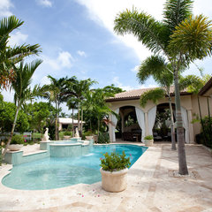 tropical pool by Complete Home Improvement Group Inc.