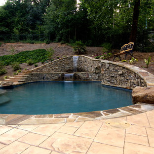 Mid-sized mountain style backyard brick and custom-shaped natural pool fountain photo in Atlanta