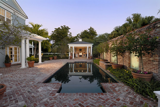Traditional Pool by Torre Construction & Development