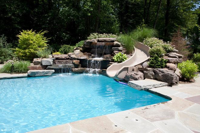 Traditional Pool by Thomas Flint Landscape Design & Development
