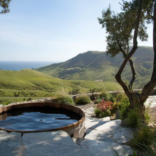 Design ideas for a small country round aboveground pool in Santa Barbara with a hot tub and natural stone pavers.