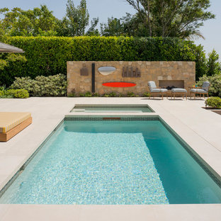 Photo of a mid-sized contemporary backyard rectangular lap pool in Los Angeles with a hot tub and concrete slab.