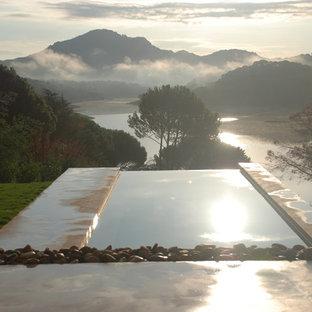 Diseño de casa de la piscina y piscina infinita, rural, de tamaño medio, rectangular, en azotea