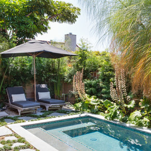 Inspiration for a small beach style backyard rectangular pool remodel in Orange County