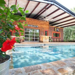 Pool - rustic brick and rectangular pool idea in Dallas
