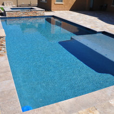 Traditional Pool by Straight Line Landscape