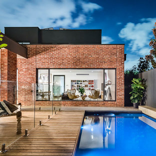 Inspiration for a large contemporary backyard rectangular lap pool in Adelaide with decking.