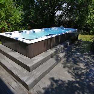 This is an example of a traditional backyard pool in San Francisco with a hot tub.