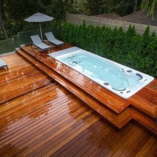 Imagen de piscinas y jacuzzis contemporáneos en patio trasero