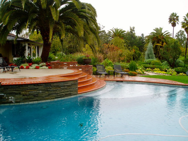 Traditional Pool by The Design Build Company