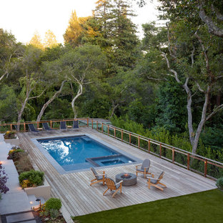 This is an example of a large modern back rectangular swimming pool in San Francisco with decking.