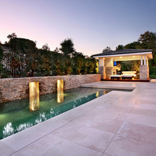 Traditional Pool by Urban Landscape
